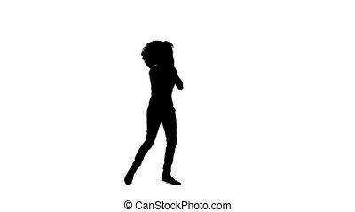 Silhouette of an excited woman dancing