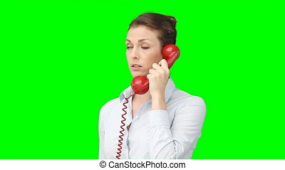 A woman talks on the telephone
