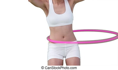 Close up of a woman using a hula hoop against a white...