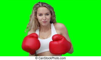 A woman punching forward at the camera