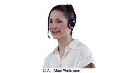 Business talking into a headset before looking at the camera