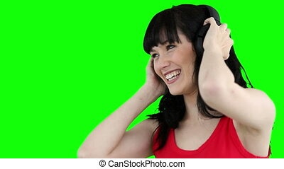 Woman wearing headphones while dancing