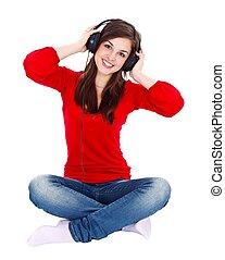 Woman listening music - Young woman listening music on...