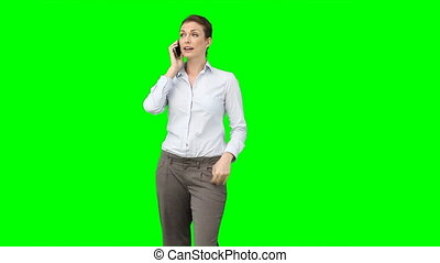 A business woman talks on her mobile phone