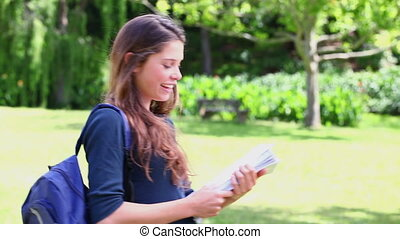Happy student holding her notebook
