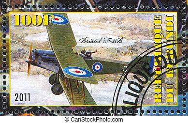 biplane - BURUNDI - CIRCA 2011: stamp printed by Burundi,...
