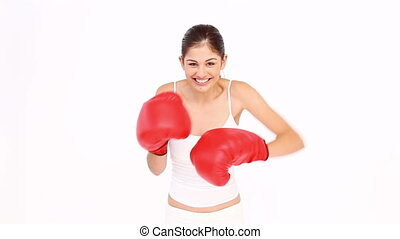 Woman boxing against white background