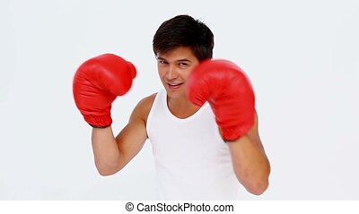 Happy man boxing against white background