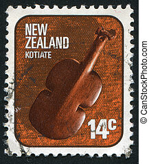 violin-shaped weapon - NEW ZEALAND - CIRCA 1976: stamp...
