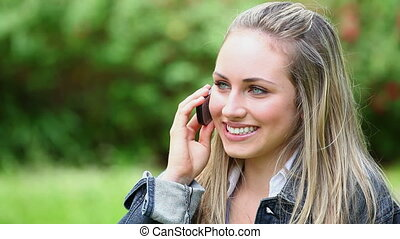Happy woman using her cellphone