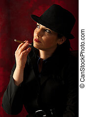 Woman smoking and looking away - Woman smoking in darkness...
