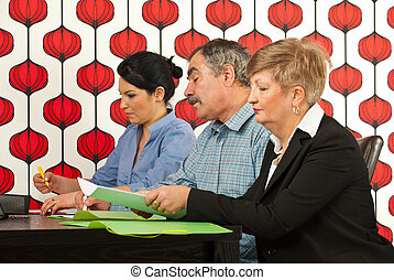 Business people working together - Three business people...
