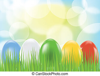 Colored easter eggs on green background with grass
