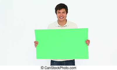 Man holding a sign against white background
