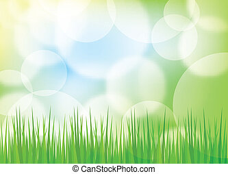 Green spring background with grass and blurry light