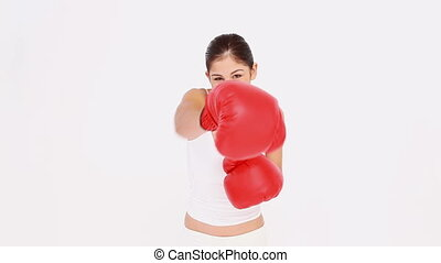 Happy woman continues to box