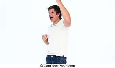 Happy man raising arm and shouting against white background