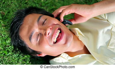 Happy man using his cellphone