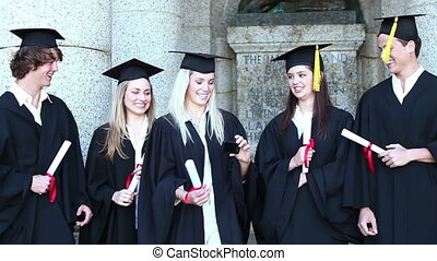 Graduates take self portrait together on front of the...
