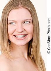 Beautiful young girl with brackets on teeth close up