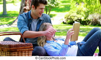 Couple picnicking in a park