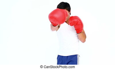 Man practising his boxing against a white background
