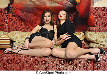 two beautiful women in oriental interior