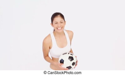 Woman grabs a football against white background