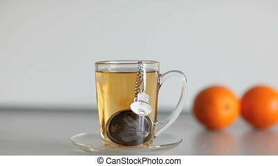 cup of tea - cup of strong black tea biscuit and two orange
