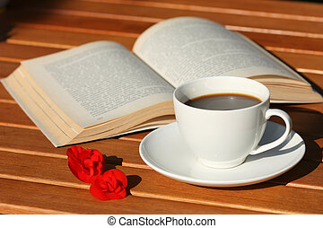 Book and coffee - Cup of coffee and book. Reading in the...