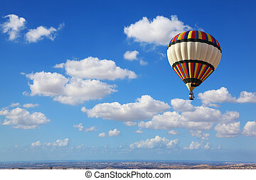 Huge air balloon flying in the cloudy sky