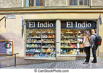 Tourists near the gift shop El Indio in Stockholm -...