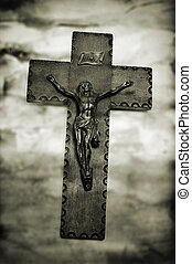 Jesus Christ in the holy cross - vintage background with the...