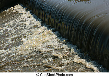 Polluted water waterfall in water treatment plant