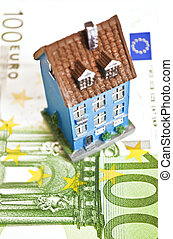 House with money - mortgaging concept