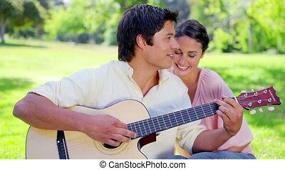 Smiling brunette woman listening to her boyfriend