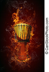 African drum in fire on black background