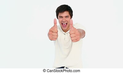 Smiling man the thumbs-up against white background