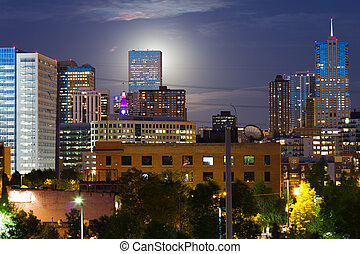 Glowing Moon Rises Behind The Denver CO Skyline - An eerie...