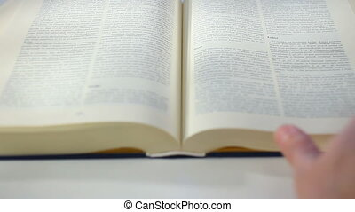 Bible Book scrolling by hand