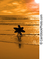 angelic surfing couple silhouette - silhouette of surfing...
