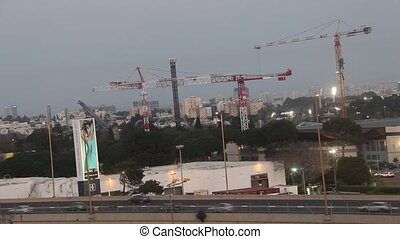 Buildings construction - Tel Aviv at dusk Buildings...