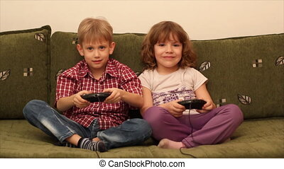 boy and little girl play video game