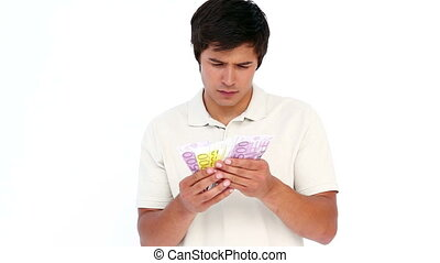 Man counting his banknotes against white background
