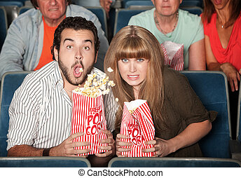 Couple Spills Their Popcorn - Scared Caucasian couple in...