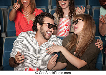 Laughing Couple In Theater