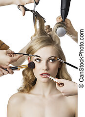 in beauty salon,the girl looks at left - woman getting a...