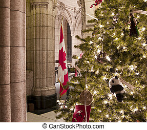 Patriot Christmas - A canadian flag and Christmas tree at...
