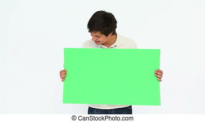 Man holding a commercial sign against white background