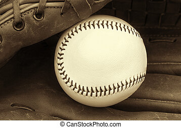 New Baseball - New baseball in worn glove in sepia tones